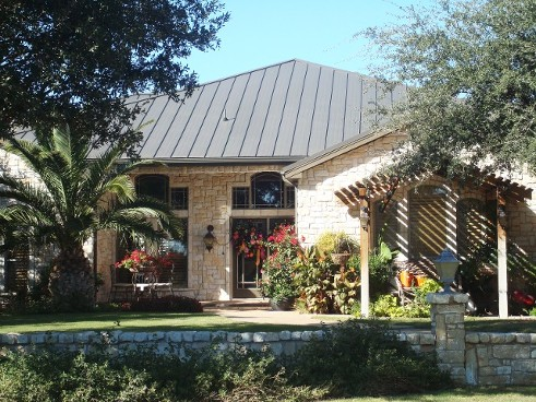 Brown Standing Seam Roof  - Stone Walls